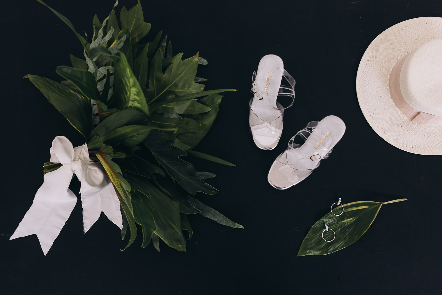Minimalist styled bridal accessories including bouquet, shoes and hat