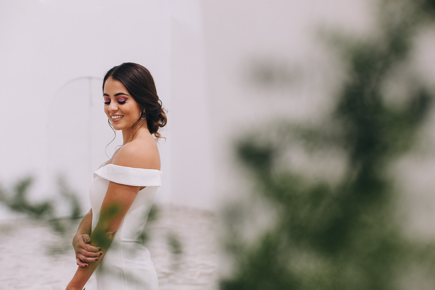 Mexican bride smiling and looking down