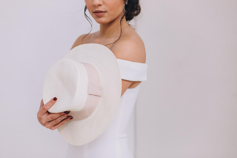 Minimalist bride holding a Mexican sombrero
