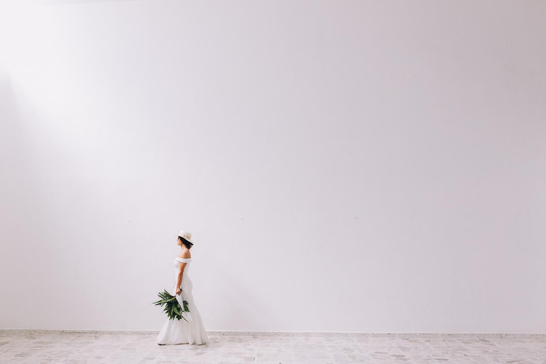 Minimalist wedding Mexico bride walking away